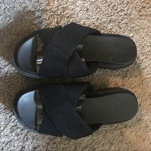 Black platform criss cross sandals